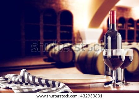 retro photo of few barrels and kitchen desk and wine  - stock photo