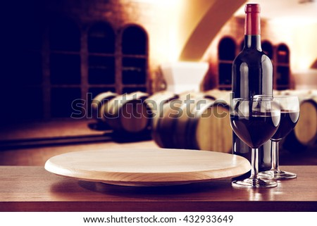 retro photo of few barrels and kitchen desk wine and bottle and free place  - stock photo