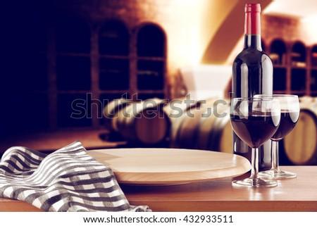 retro photo of few barrels and wine and kitchen desk  - stock photo