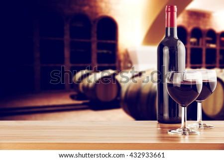 retro photo of few barrels and wine on shelf  - stock photo