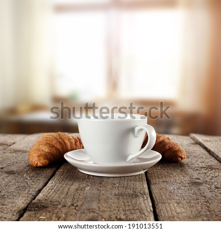 retro photo of shabby table croissants and cup  - stock photo