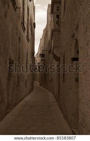 Retro photo of Street in old European town (Mdina, Malta) - stock photo