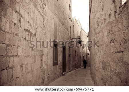 Retro photo of street in old mediterranean town (Mdina, Malta) - stock photo