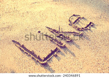 Retro Photo Of The Word Like Written On Sand - stock photo