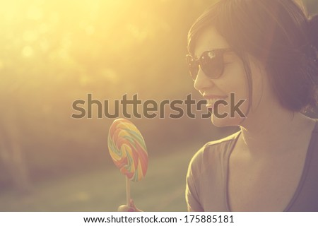 Retro photo of woman with lollipop