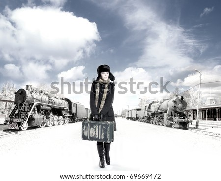 Retro photo of young and attractive woman on the train station - stock photo