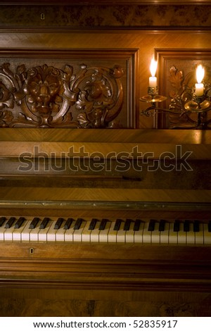 Retro Piano with ivory keys and candle light - stock photo