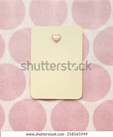 Retro pink album page layout. Vintage paper blank label card embellished with heart decoration. Dotted pattern background. May be used for a graphic art, as a greeting or gift layout, brochure or web. - stock photo