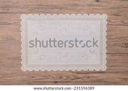 Retro place mat on wooden deck table. - stock photo