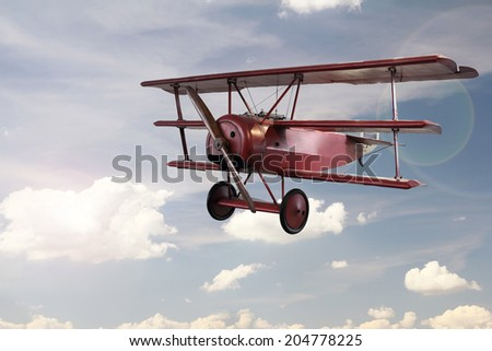 retro plane flying on sky - stock photo