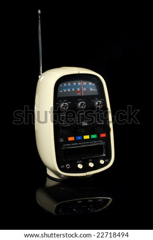 Retro portable eight track tape player & radio isolated on black background - stock photo