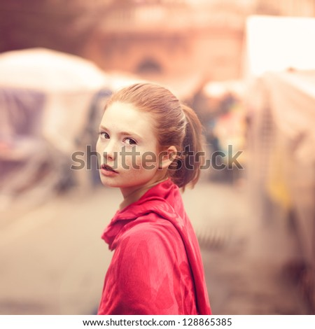 retro portrait of a beautiful girl on the streets of the old town - stock photo
