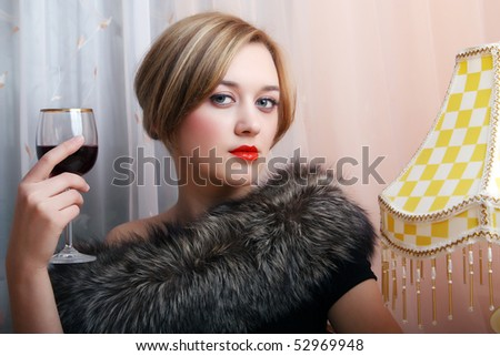 Retro portrait of a beautiful sexy girl with a glass of wine - stock photo