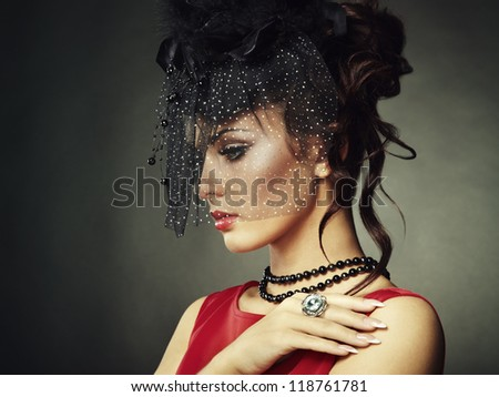 Retro portrait of a beautiful woman. Vintage style. Fashion photo - stock photo