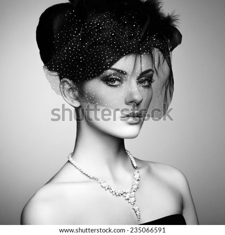 Retro portrait of a beautiful woman. Vintage style. Perfect make-up. Fashion photo. Black and white photo - stock photo