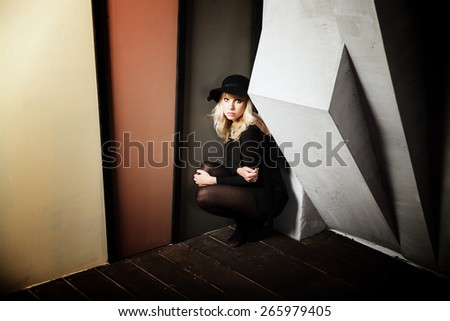 Retro portrait of a beautiful young woman wearing a hat