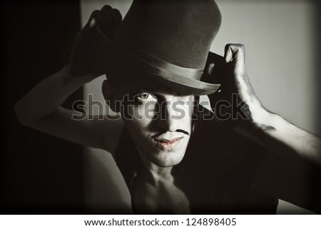 Retro portrait of a theatrical actor with a hat - stock photo