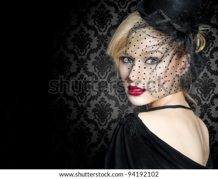 Retro portrait of a young woman with vintage hat