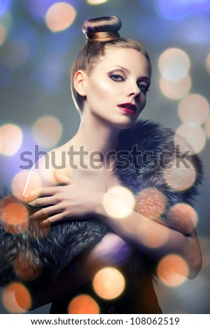 Retro portrait of beautiful woman in fur coat - stock photo