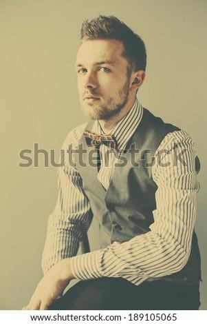 Retro portrait of gentleman in suit and bowtie - stock photo