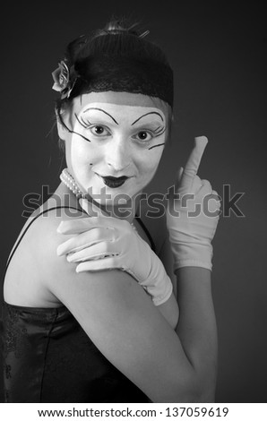 retro portrait of smoking mime over dark background