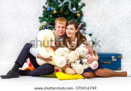 Retro portrait of young couple near New Year fir - stock photo