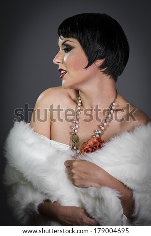 Retro posing lady,  flapper dress, Girl dreaming beautiful young woman from roaring 20s looking at camera.  vintage twenties - stock photo