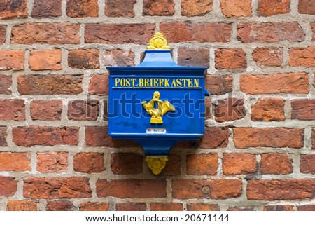 Retro Postbox on a Brick Wall in the Germany - stock photo