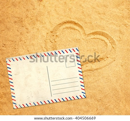 Retro postcard on sand texture - stock photo