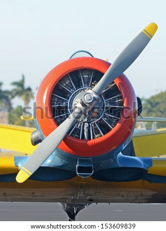Retro propeller airplane front view - stock photo