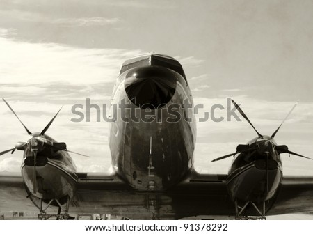 Retro propeller airplane front view - stock photo
