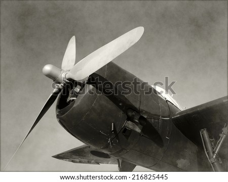 Retro propeller airplane nose view old stained black and white - stock photo