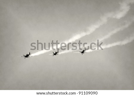 Retro propeller airplanes flying in formation - stock photo