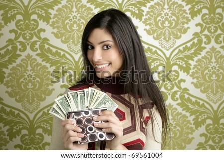 retro purse dollar woman smiling on vintage green wallpaper - stock photo