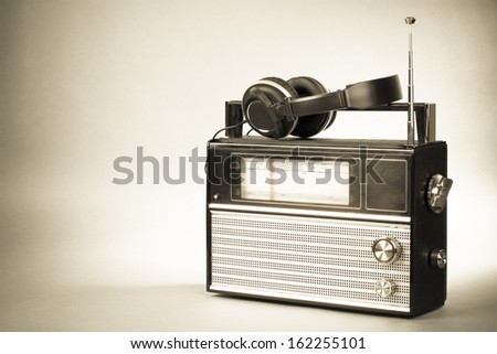 Retro radio and headphones old vintage sepia photo - stock photo