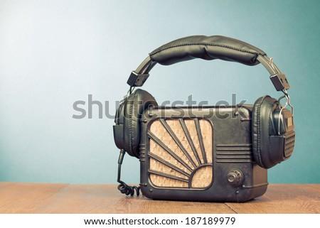 Retro radio and headphones on table - stock photo