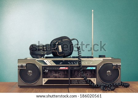 Retro radio cassette recorder and headphones - stock photo
