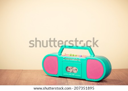 Retro radio cassette recorder in mint green and pink colors - stock photo