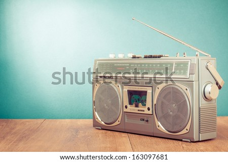 Retro radio cassette recorder on mint green background - stock photo