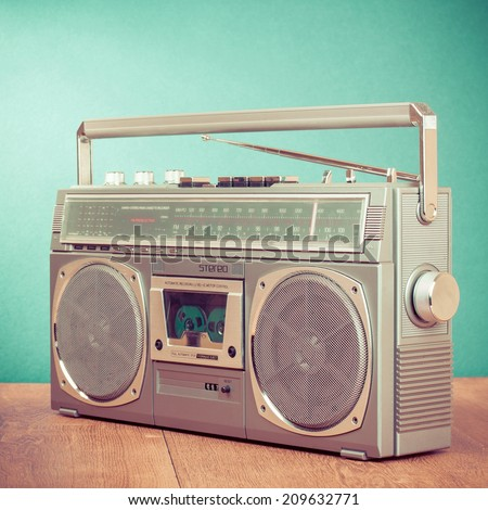 Retro radio cassette stereo recorder front mint green background - stock photo