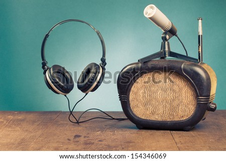 Retro radio, headphones and microphone old style photo - stock photo