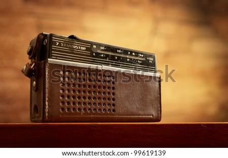 retro radio on grunge blurred wall background - stock photo