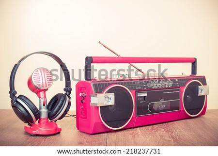 Retro radio recorder from 80s, microphone and headphones - stock photo