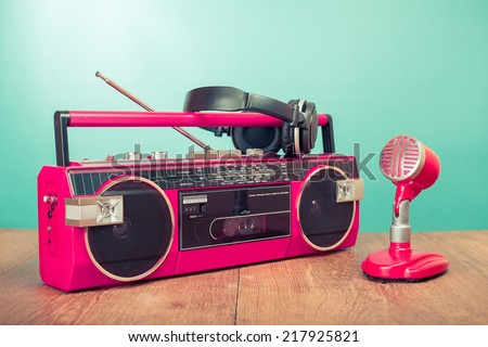 Retro radio recorder from 80s, microphone and headphones front mint green background - stock photo