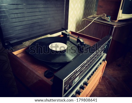 Retro record player, detail shot, image toned and noise added - stock photo