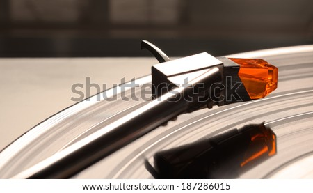 Retro record player turntable with vinyl record (LP) with analog sound level meter meters in background. Selective focus. - stock photo