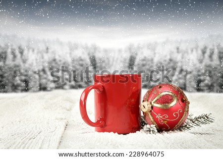 retro red ball and snow with mug of red color  - stock photo