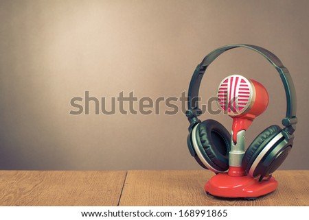 Retro red microphone and headphones front gradient background - stock photo