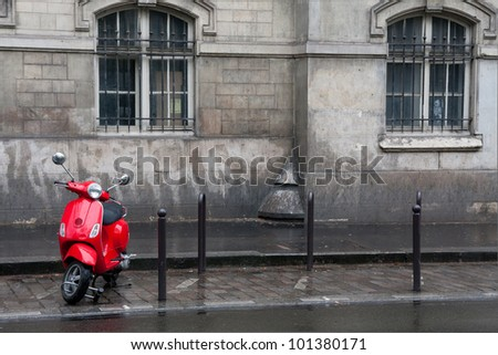Retro red scooter in Paris street - stock photo