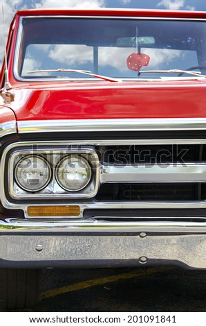 retro red truck with red fuzzy dice - stock photo